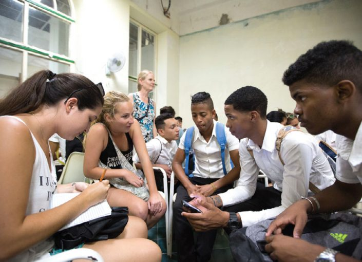 Student's in the College's study-abroad program interact with Cuban students, discussing the cultural differences between Cuba and the United States.